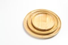 Деревянные плиты или подносы изолировали белую предпосылку Стоковое Изображение