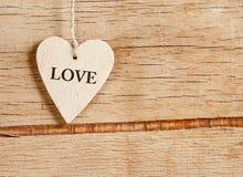 Деревянные сердца на деревянной предпосылке Стоковая Фотография