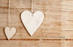 Деревянные сердца на деревянной предпосылке Стоковые Фото
