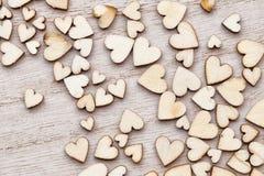 Деревянные сердца, на предпосылке сердца Стоковые Фото