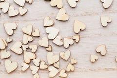Деревянные сердца, на предпосылке сердца Стоковая Фотография RF