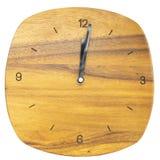 Деревянные часы изолированные на белой предпосылке с путем клиппирования стоковая фотография