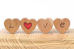 Деревянные часы с текстом влюбленности Стоковые Изображения