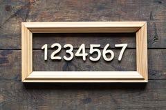 Деревянные числа в рамке Стоковая Фотография RF