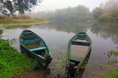 Деревянные шлюпки на реке утра Стоковое фото RF