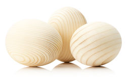 Деревянные яичка на белой предпосылке Стоковая Фотография RF