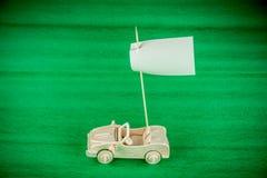 Деревянный автомобиль игрушки с флагом парламентера Стоковая Фотография RF