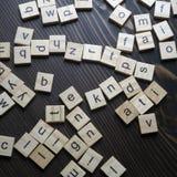 Деревянный алфавит блоков на деревянном столе стоковая фотография