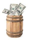 Деревянный бочонок с 100 долларовыми банкнотами Стоковые Изображения