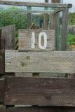 Деревянный знак давая номер графика сада Стоковое Изображение RF