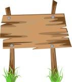 Деревянный знак на траве Стоковое Фото