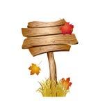 Деревянный знак с травой и листьями осени Стоковая Фотография