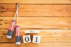Деревянный календарь блока на День труда, 1-ое мая Стоковое Фото