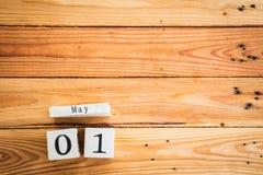 Деревянный календарь блока на День труда, 1-ое мая Стоковые Изображения RF