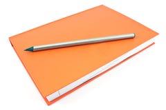 Деревянный карандаш на красной тетради Стоковые Изображения