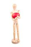 Деревянный манекен держа пасхальное яйцо Стоковые Изображения
