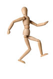 Деревянный манекен человека на изолированной белой предпосылке Стоковое фото RF
