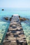Деревянный мост к морю Стоковые Изображения