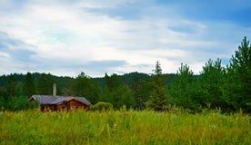 Деревянный дом в лесе Стоковое фото RF