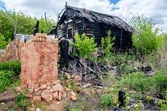 Деревянный дом после огня Стоковые Фотографии RF