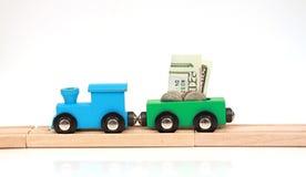 Деревянный поезд денег игрушки Стоковые Изображения