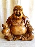 Деревянный смеясь над Будда Стоковые Фотографии RF