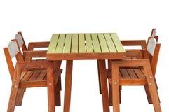 Деревянный стол и стул изолированные на белизне Стоковая Фотография