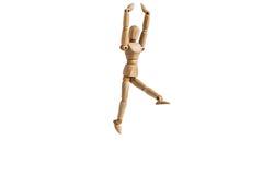 Деревянный человек куклы выполняет танец и гибкость Стоковое фото RF