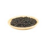 Деревянный шар сухих черных фасолей изолированных на белизне Стоковая Фотография RF