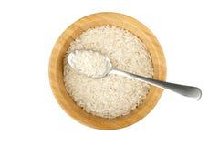 Деревянный шар с ложкой риса и стали Стоковая Фотография