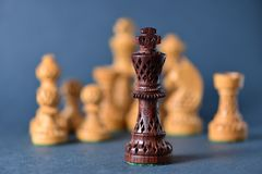 Деревянный шахмат на серой предпосылке Стоковое Изображение RF