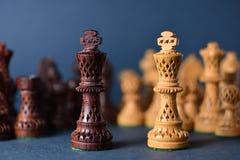 Деревянный шахмат на серой предпосылке Стоковое фото RF