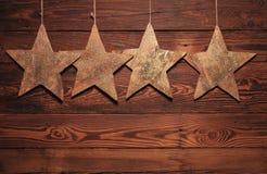 4 деревянных звезды для рождества Стоковое фото RF