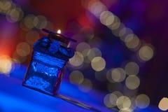 Держатель для свечи с предпосылкой bokeh Стоковые Изображения