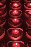 Держатели для свечи сердца с освещенными свечами внутрь Стоковые Изображения RF