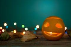 Держатель для свечи на хеллоуин сделал от апельсина Стоковые Фото