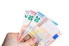 Держать бумажные деньги евро в руке на белой предпосылке Стоковая Фотография RF