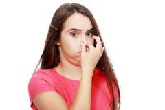 Держать ее нос Стоковое фото RF
