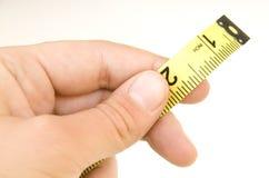 держать измеряя ленту Стоковые Фото
