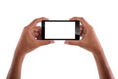 Держать мобильный телефон Стоковое Фото