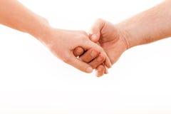 Держать пар рук на белой предпосылке. Стоковая Фотография RF