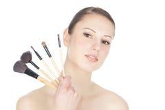 держать brushs составляет женщину молодую Стоковое фото RF