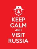 Держите плакат спокойному и посещению России красного цвета Стоковые Изображения