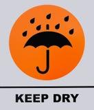 Держите сухой знак изолированный на белой предпосылке Стоковое Фото