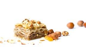 Десерт бахлавы при изолированные гайки и изюминки Стоковые Фотографии RF