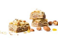 Десерт бахлавы при изолированные гайки и изюминки Стоковая Фотография