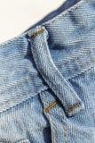 Детали голубых джинсов в молнии, карманн Стоковое фото RF