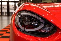 Детальная фара красное sportcar Стоковые Фотографии RF