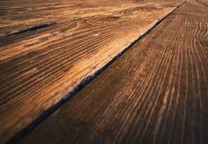 Деталь коричневого деревянного floorboard Стоковое Фото