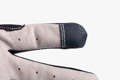 Деталь сенсорной панели пальца задействуя перчатки стоковое изображение